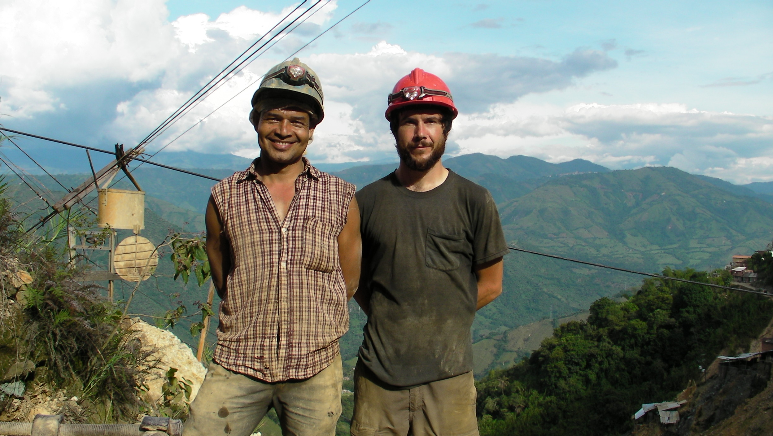 Marmato Director Mark Grieco (R) stands with José Dumar, a miner (L)