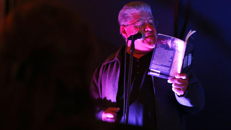 """Luis Rodriguez reads from his book """"Poems Across the Pavement. Photo: LA Times"""