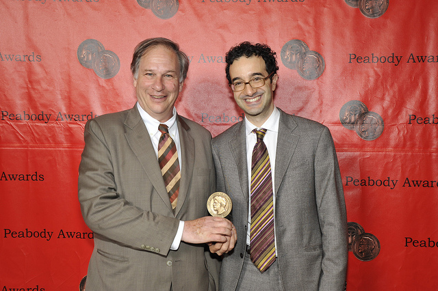 """Krulwich and Abumrad hold their Peabody Award, the """"Pulitzer Prize for Radio."""""""
