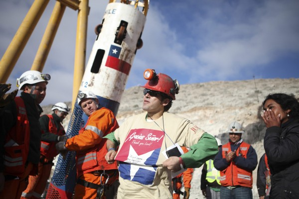 Miner Alex Vega arrives as the tenth to be rescued in Copiapo