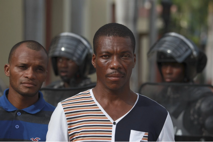 """Haitians stand in front of the National Palace while waiting to register in the  """"regularization"""" program in Santo Domingo. Ricardo Rojas/Reuters"""