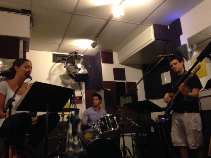 The musicians rehearse.