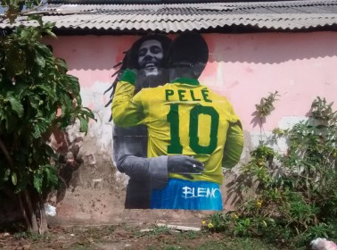 This is the Artist Behind the Wheatpastes of Pelé Smooching Cultural Icons Popping Up Across São Paulo
