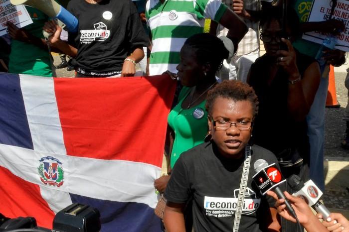 Activist Ana Maria Belique, founder of Reconoci.do, protests the one year anniversary of Law 168-13. Photo: Orlando Ramos/Acento.com.do