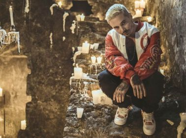 "J Balvin Unleashes His Nerdy Alter Ego & Makes Out in a Sex Cave in the Video for ""Bobo"""