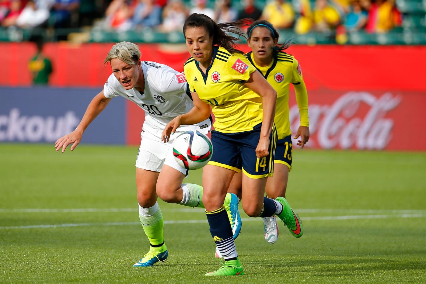 EDMONTON, AB - JUNE 22: Nataly Arias #14 of Colombia controls the ball against Abby Wambach #20 of the United States in the FIFA Women's World Cup 2015 Round of 16 match at Commonwealth Stadium on June 22, 2015 in Edmonton, Canada. (Photo by Kevin C. Cox/Getty Images) ORG XMIT: 528451983
