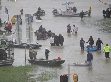 This 60-Year-Old Latina Walking to Work in Waist-Deep Water Lays Bare Immigrant Reality
