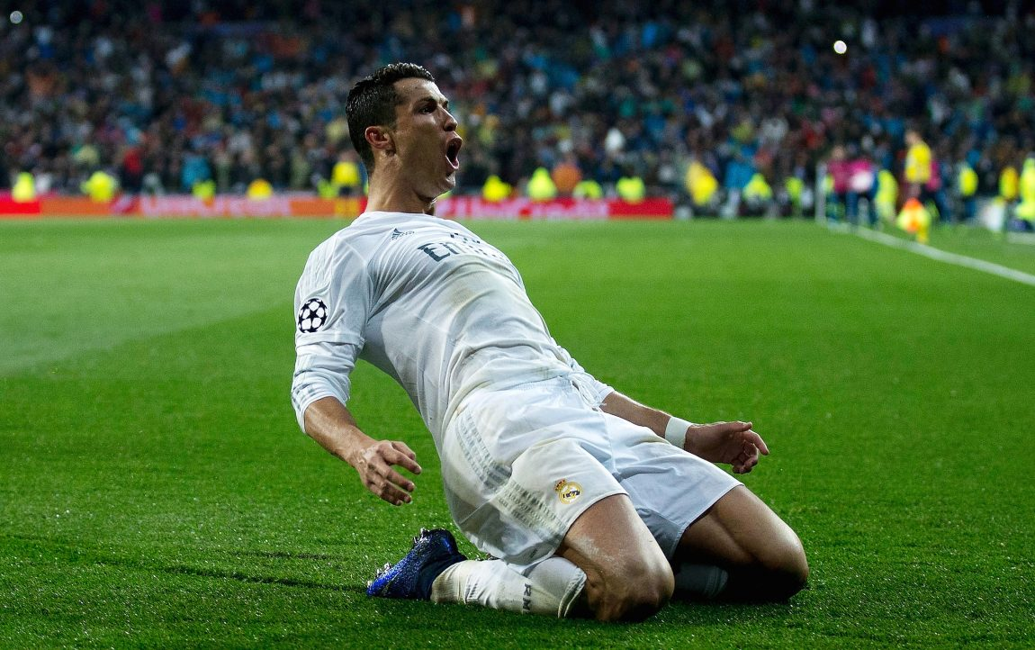 491ed52417e Cristiano Ronaldo celebrates as he completes his hat trick during the UEFA  Champions League quarter final match between Real Madrid CF and VfL  Wolfsburg at ...