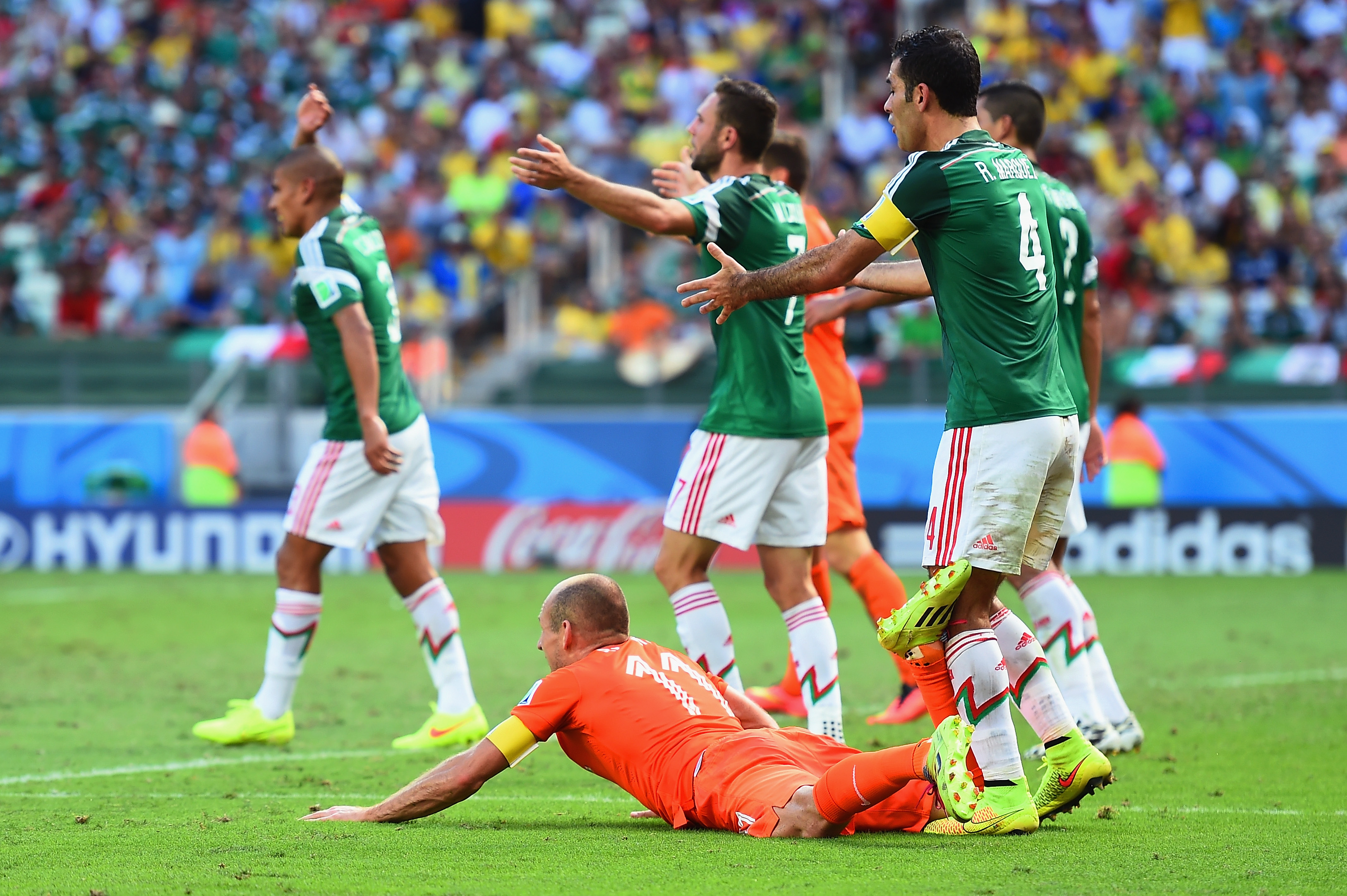 c169718dd Rafael Marquez of Mexico reacts after a challenge on Arjen Robben of the  Netherlands resulting in a yellow card for Marquez and a penalty kick for  the ...