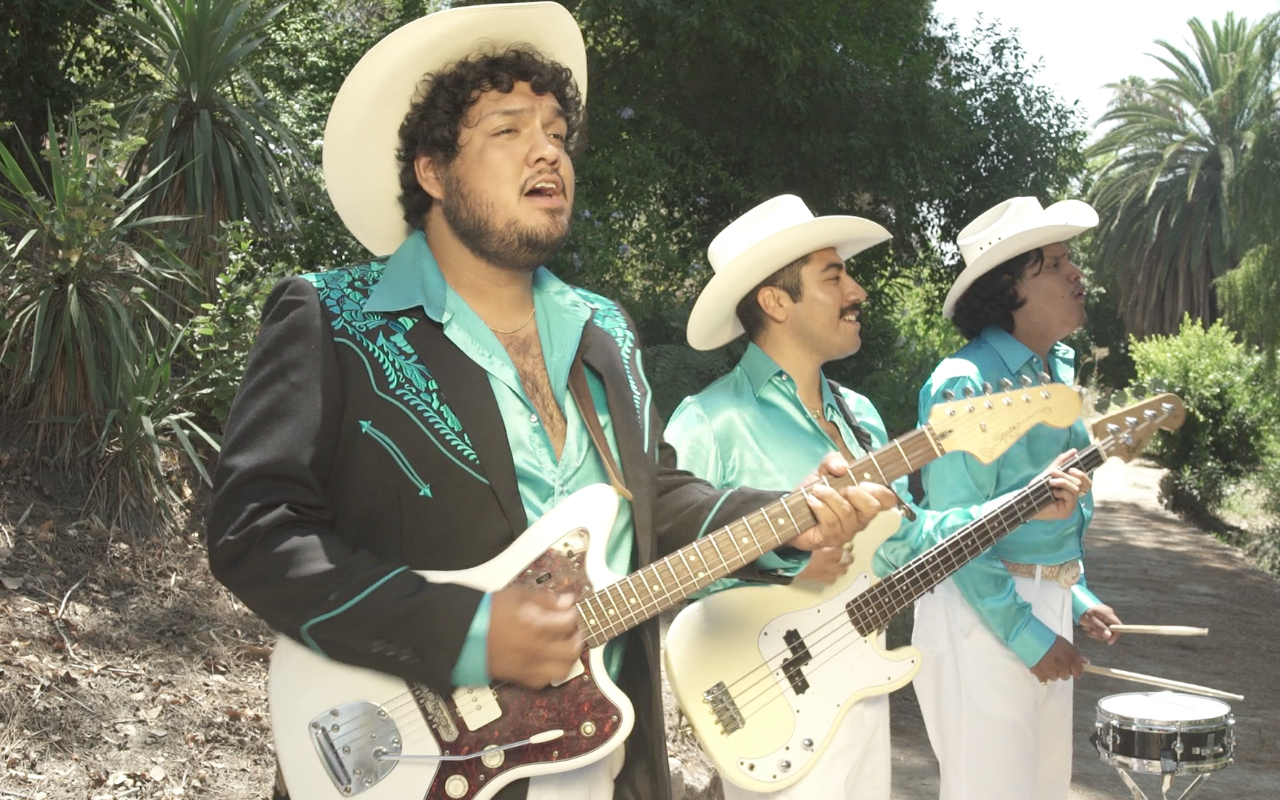 """Thee Commons' """"Camisa al Revés"""" Video Is a Brilliantly Cheesy Ode to 90s Quinceañeras"""