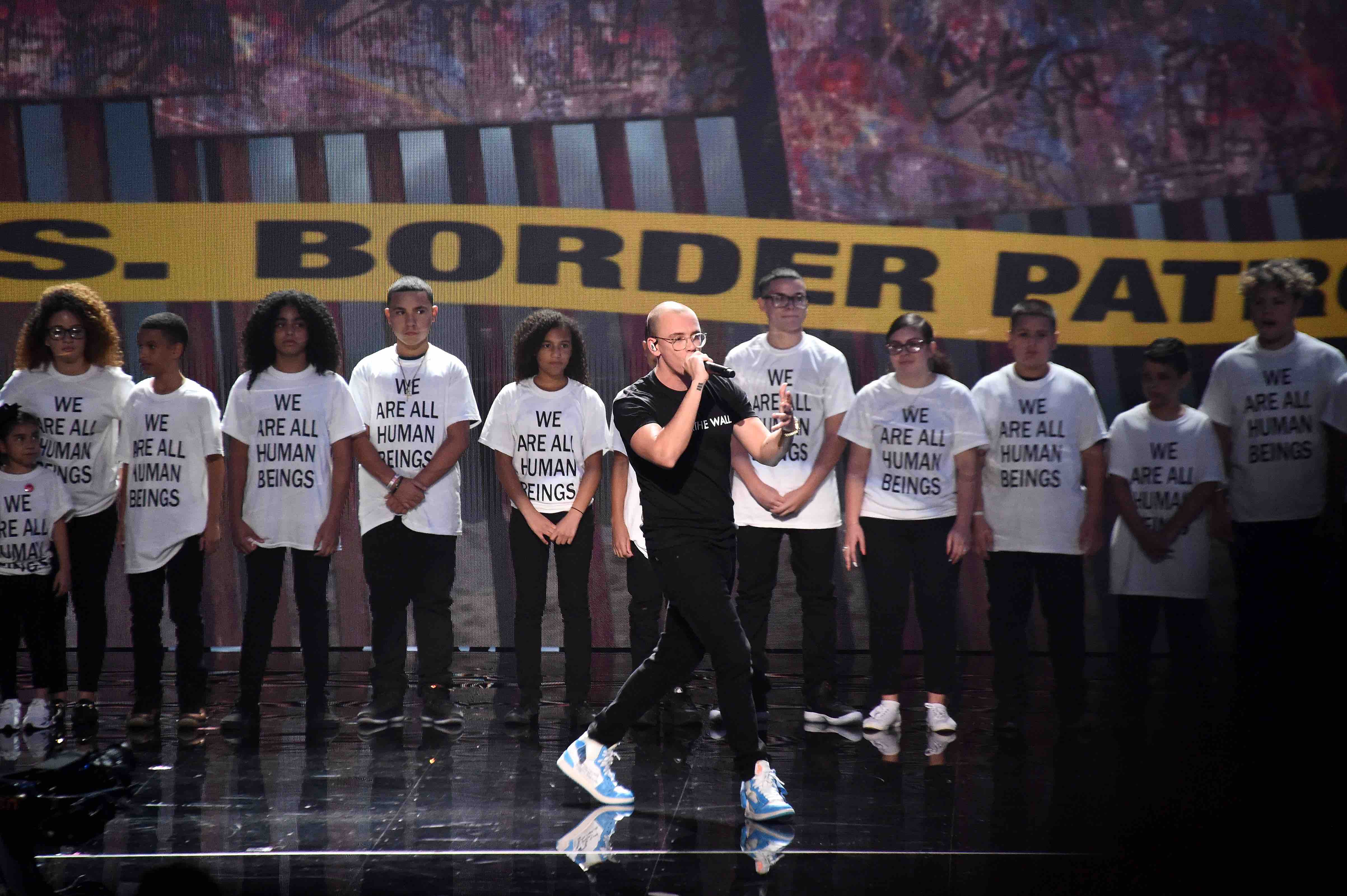 He Was a Part of Logic's Powerful Immigration Protest at the VMAs. His Father Remains in a Detention Center