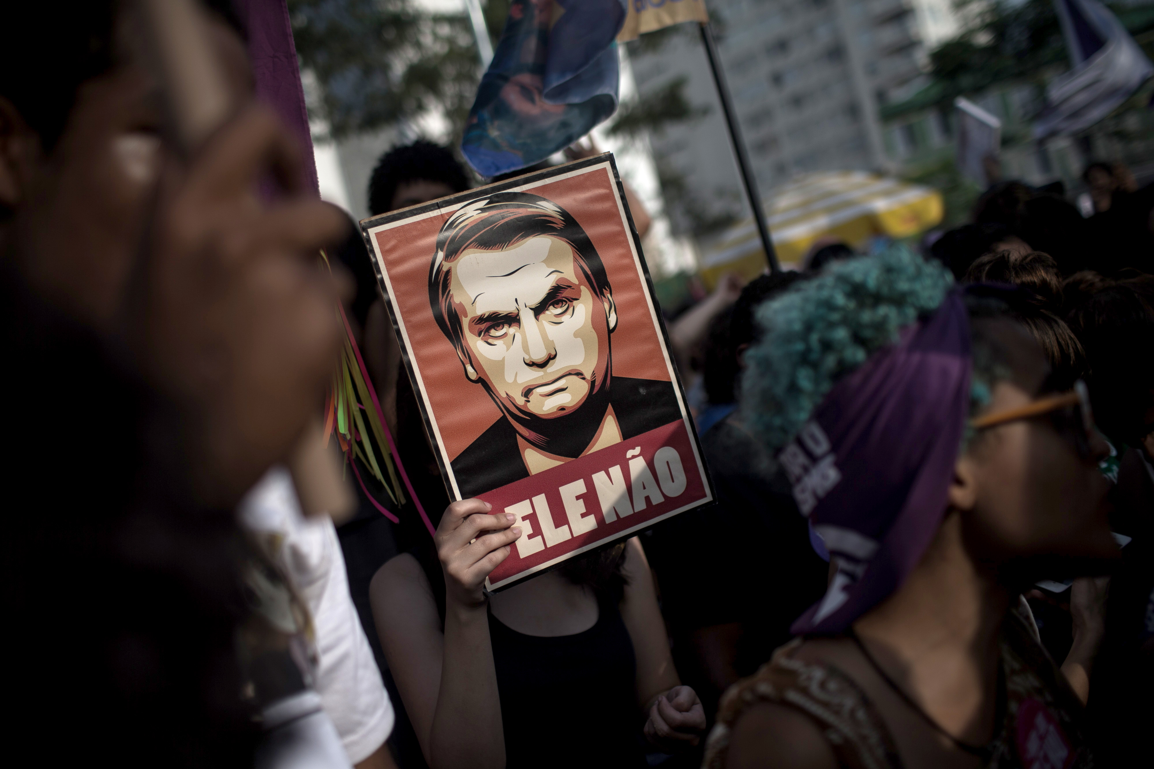 In Brazil, Bolsonaro Supporter Carved a Swastika on a Young Woman's Skin Because of Her #EleNao Tee
