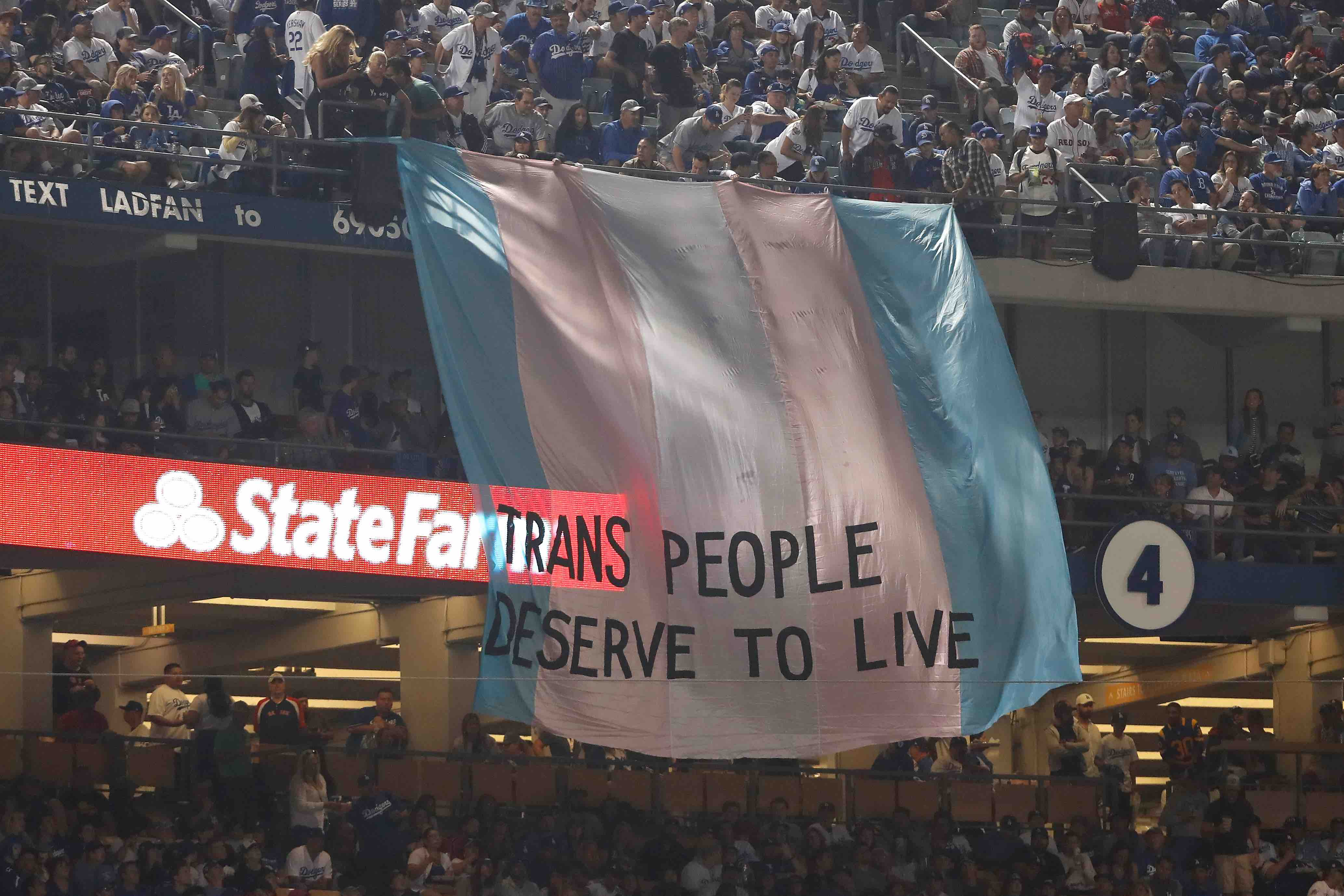 Meet the Latina-Led Organization That Unfurled the Trans Rights Banner at the World Series Final