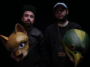 "Rappers Guanaco and Emicida Celebrate Indigenous Pride & Resistance in ""Cholonización"" Video"