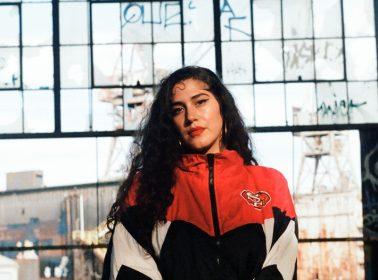 "In Folk-Meets-Reggaeton ""Nada Me Pertenece"" Video, La Doña Drinks With the Grim Reaper"