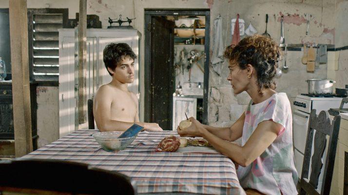REVIEW: In 'Agosto,' a Cuban Teen Pursues His Crush & Cares for His Grandma During the Balsero Crisis