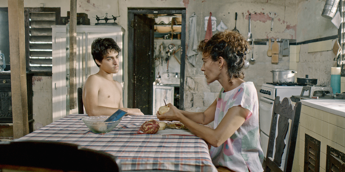 REVIEW: In 'Agosto,' a Cuban Teen Pursues His Crush & Cares for His Grandma During the Balsero Crisis