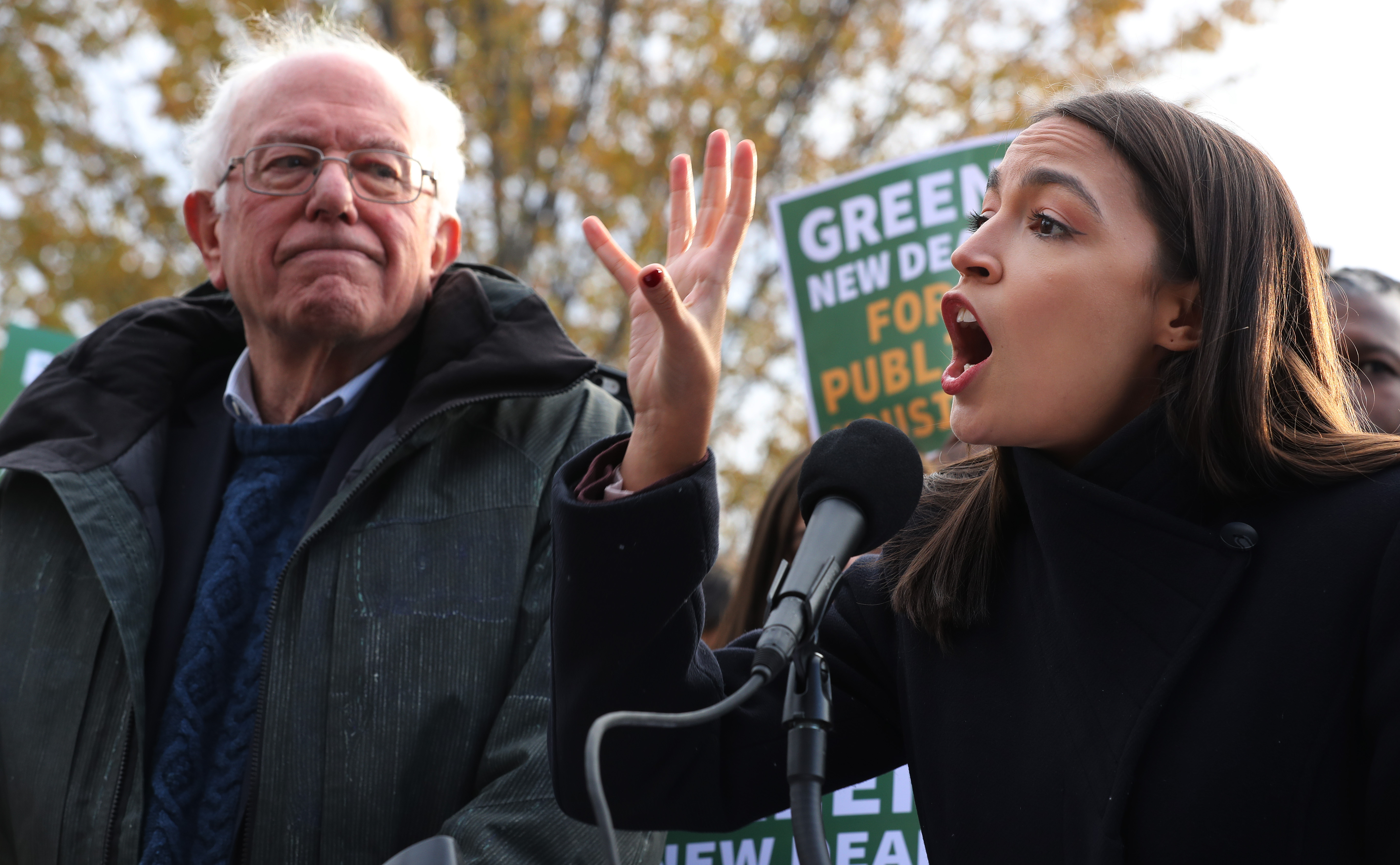 AOC & Bernie Sanders' First Green New Deal Bill Ties Public Housing With Environmental Justice