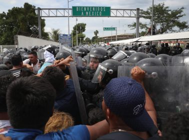 Mexico's National Guard Uses Tear Gas & Pepper Spray in Attempt to Stop Asylum Seekers at the Guatemalan Border