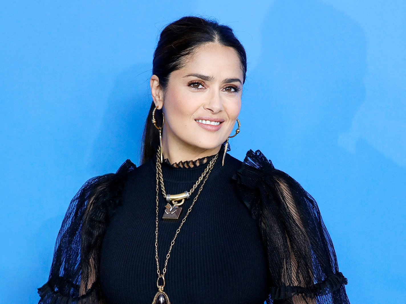 How Salma Hayek's Pet Owl, Her Husband's Company & Role in Gucci Film Are All Interconnected